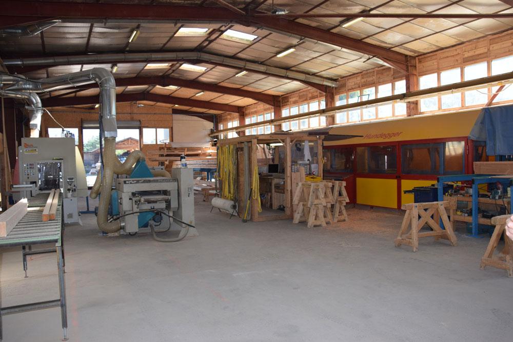 Atelier charpente fabrication panneaux bois chalets Lombard Vasina Hautes Alpes